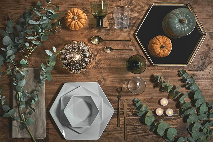 table set with small decorative pumpkins