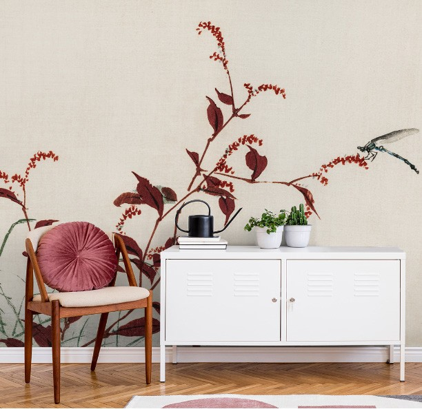 white and ruby red dragonfly wallpaper in lounge with white cabinet and chair with red cushion