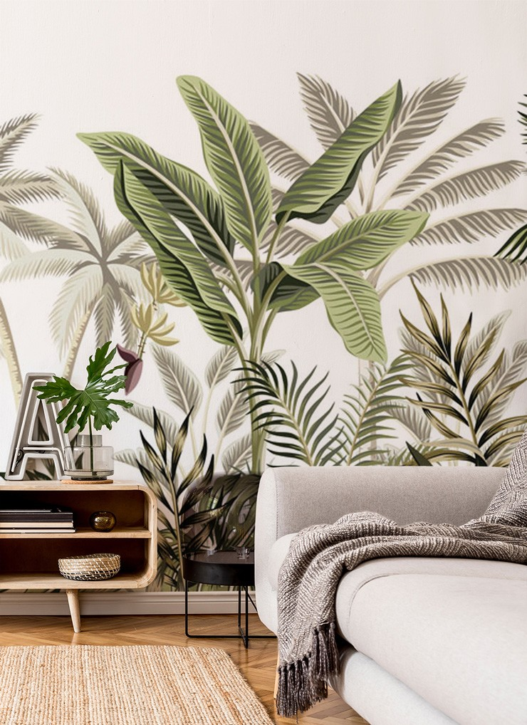 green palm leaf wallpaper in timeless interiors lounge with wooden sideboard and grey sofa