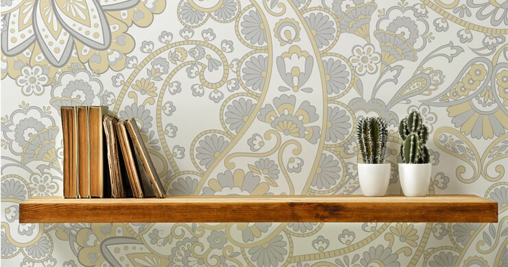 light grey and yellow retro wallpaper shelves with wooden shelf in front of it