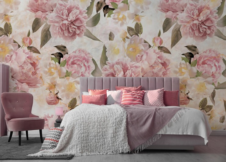 off-white, pastel pink, yellow and green floral wallpaper in pretty bedroom with pink accessories and pink chair