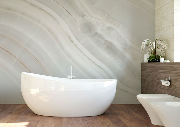 lined creamy white wallpaper in white bathroom with stand alone bath