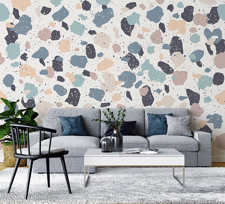 pastel pink and blue terrazzo wallpaper in grey and blue lounge