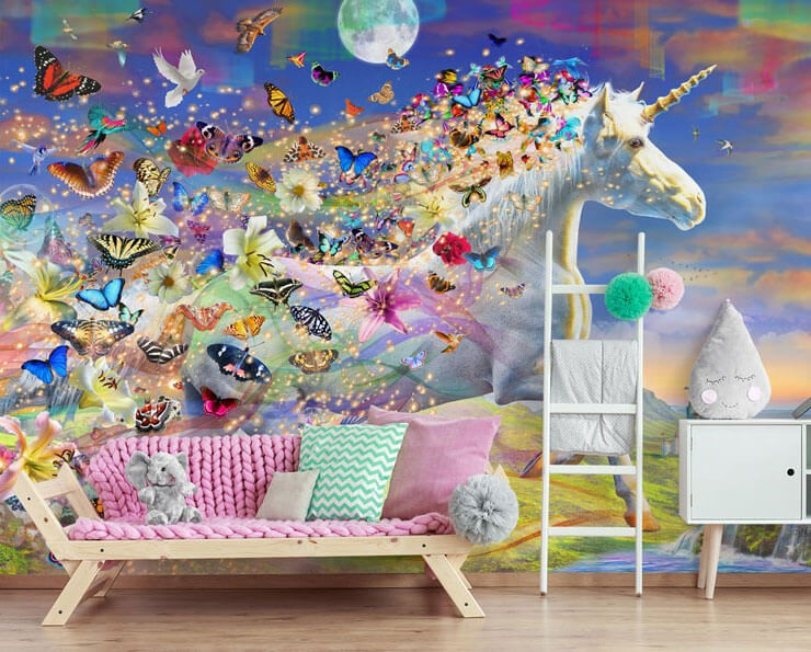 multicoloured digital art of unicorn with butterflies and glitter coming from its mane wallpaper in bedroom with pink sofa