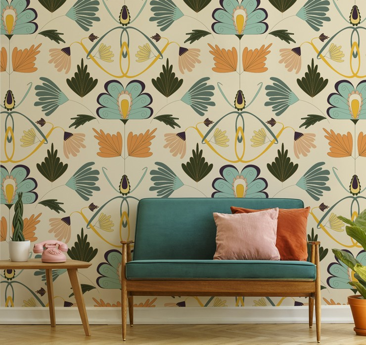 art nouveau floral wallpaper with blue, orange and pink tones in retro lounge with teal, orange and pink sofa