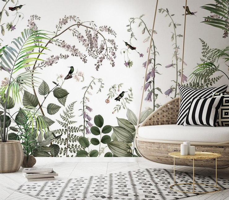 boho lounge with floral hummingbird wallpaper and wicker swinging chair and black and white patterned rug