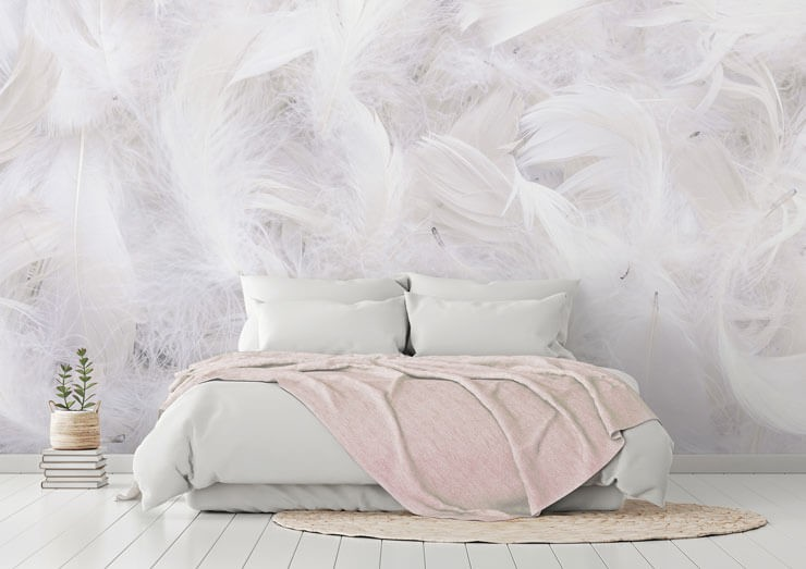 white curled feather wallpaper in bedroom with pink and white accessories