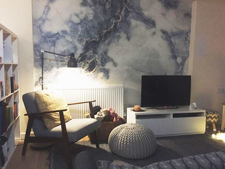 blue and white marble wallpaper in scandi living room