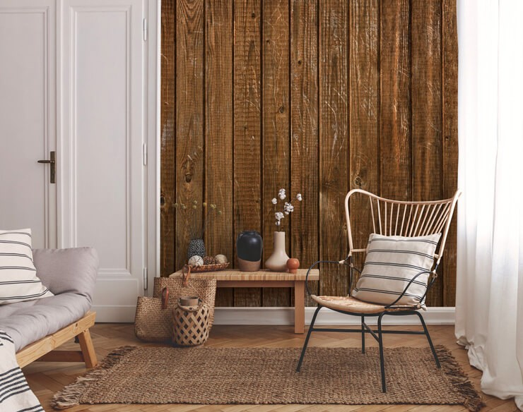 rustic wood panel wallpaper in lounge with natural wicker chair, lamp and rattan rug