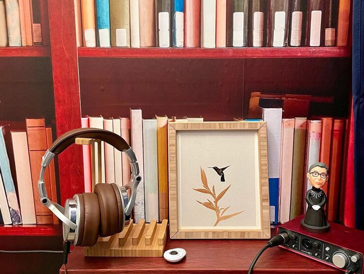 bookcase wallpaper with floating shelf holding ear phones