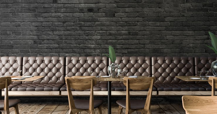 black bricks in trendy leather-seated restaurant