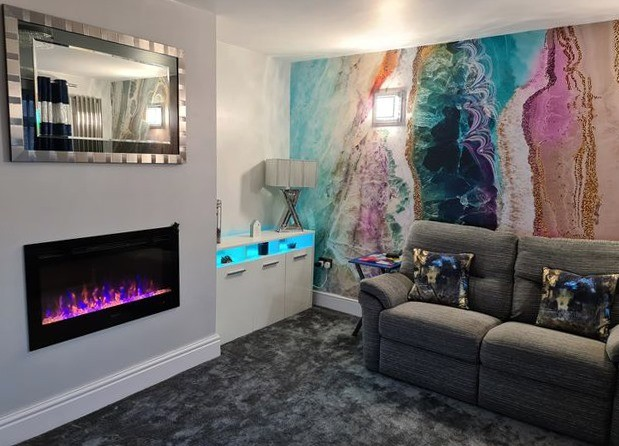 pink, blue, gold geode wallpaper in cosy grey lounge