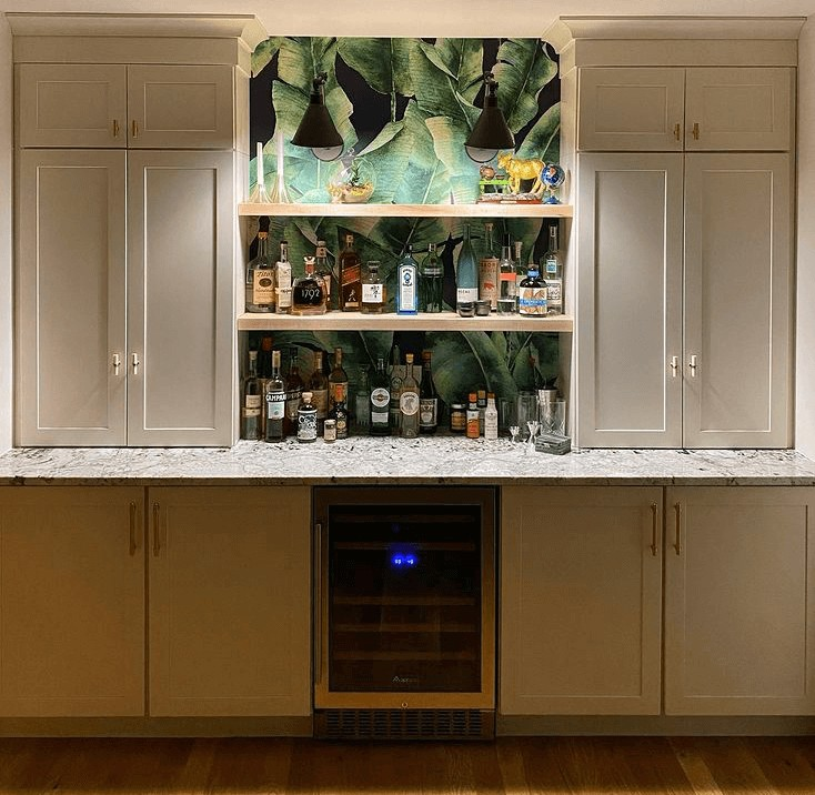dark background with green large leaf wallpaper in kitchen opening shelving