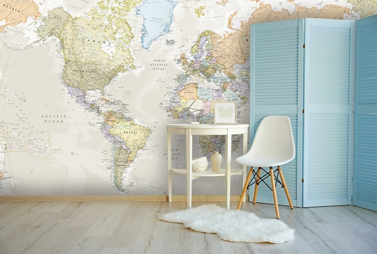 pastel toned world map wall mural in room with chair and fluffy white rug