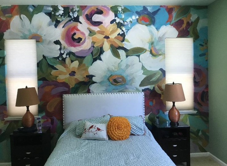colourful flower painting wallpaper in cute bedroom with green and yellow accessories