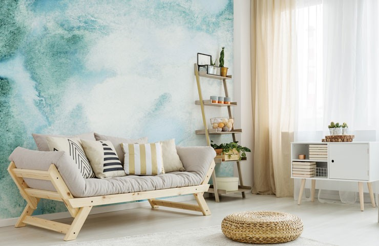 calming teal watercolour wallpaper in beach themed lounge