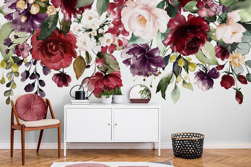 white background with maroon and plum coloured hanging flowers wallpaper in pink and white lounge
