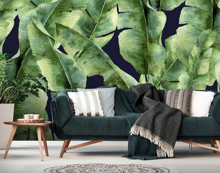 navy and green leaf wallpaper in dark lounge