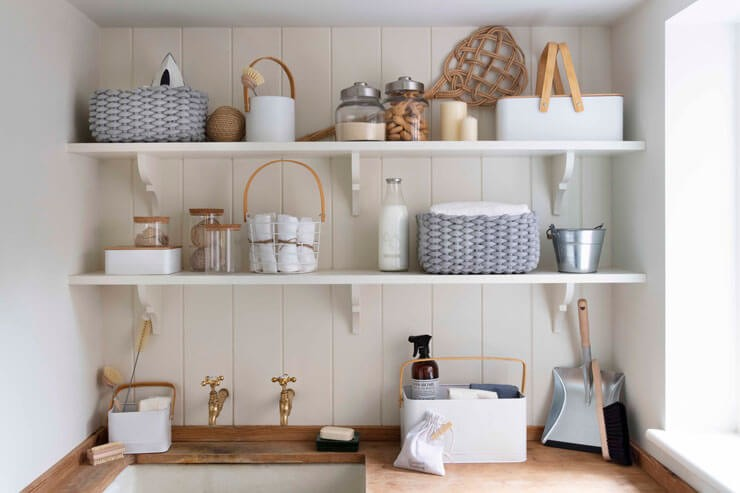 shelves with baskets and containers in laundry room