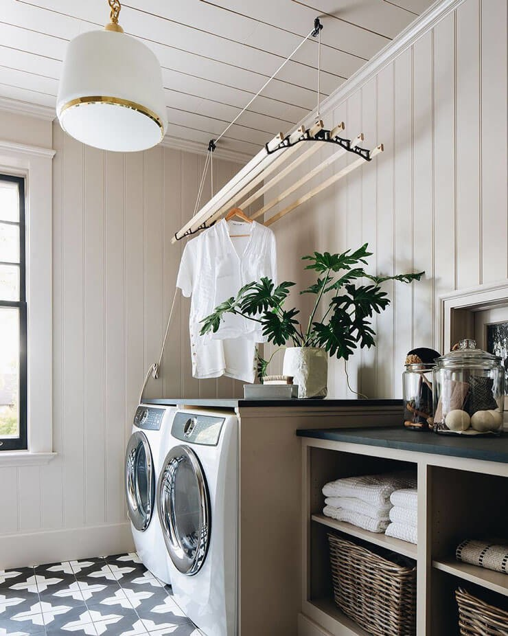 old fashioned wooden hanging drying rack in modern laundry room