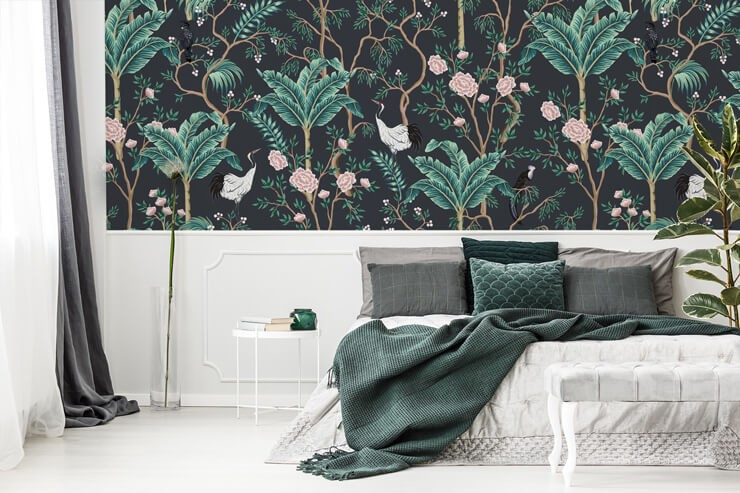 dark wallpaper with palm tree, pink flower and bird pattern in bedroom with green and white bed