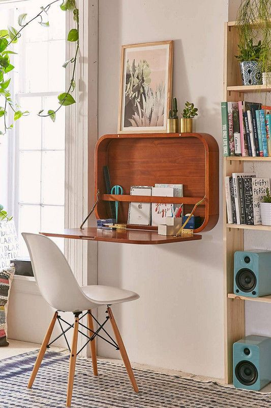 retro lounge with wooden pull out desk with white and wood chair