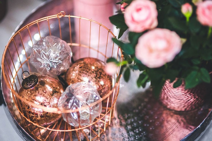 rose gold baubles and pink roses close up