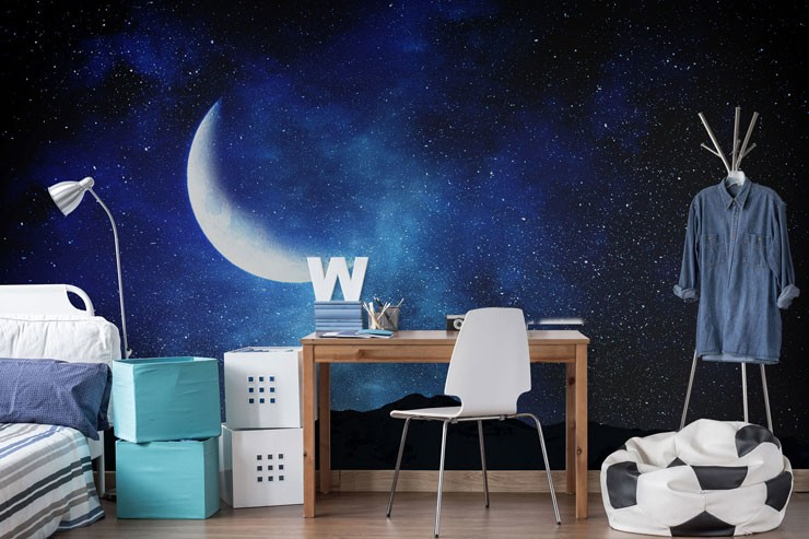 navy blue night sky with moon wallpaper in teenager's bedroom