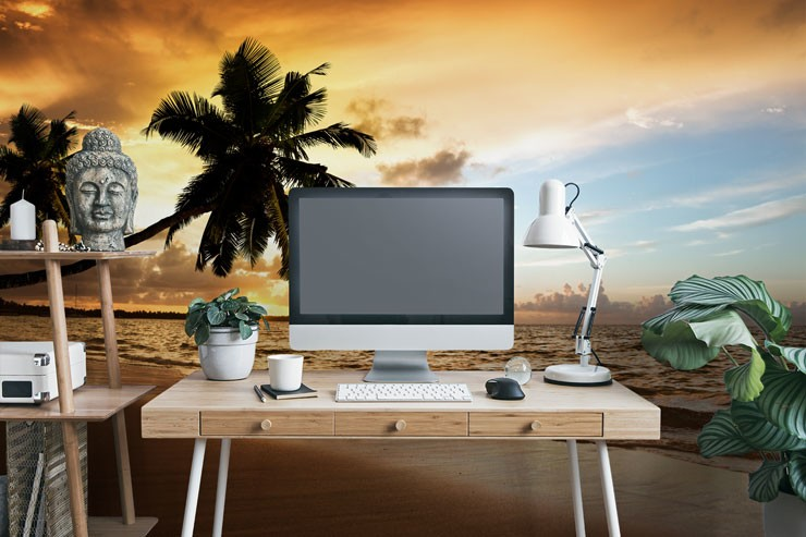 orange sunset with palm tree silhouettes wallpaper in zen home office