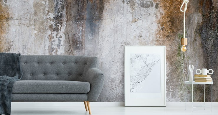 rusty old concrete wall mural in modern grey lounge