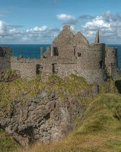 Dunluce Castle on the Coastal Causeway, County Antrim wallpaper mural thumbnail