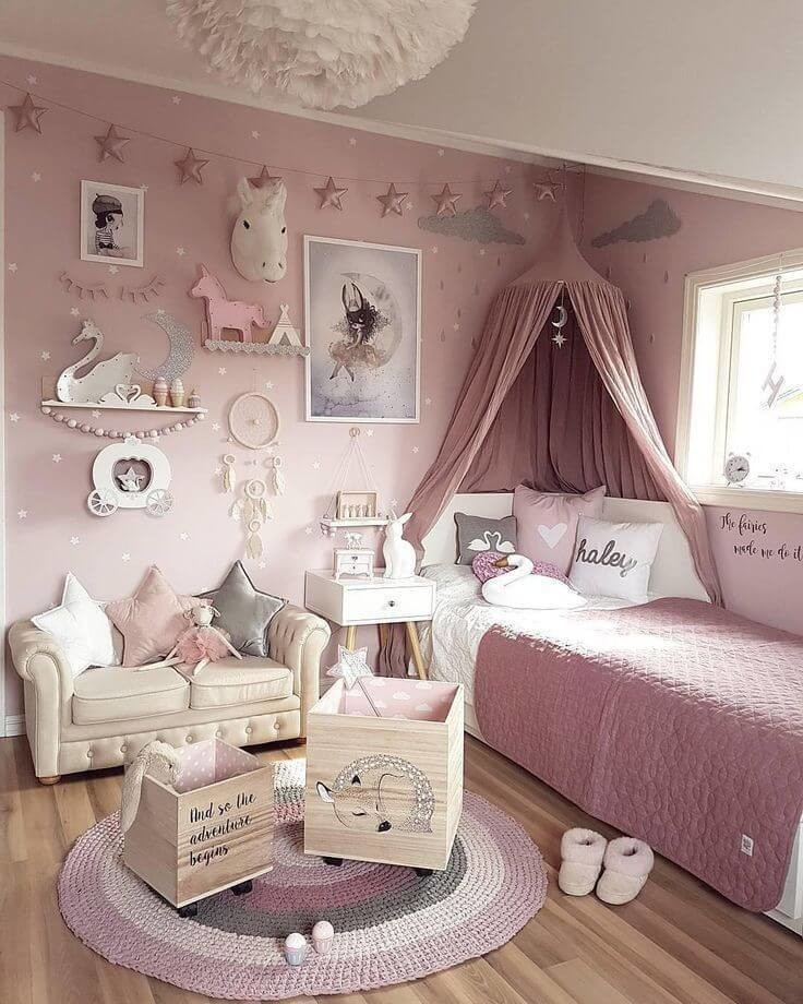pale pink princess/unicorn child's bedroom with bed canopy