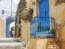 Greek Village House with Blue Door, Pyrgos wall mural thumbnail