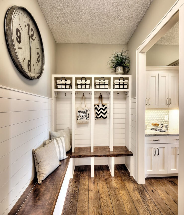 white, neutral farmhouse mudroom next to kitchen