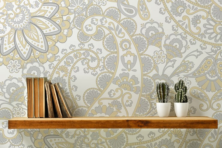 retro floral pattern wallpaper in grey and yellow tones with wallpaper shelves