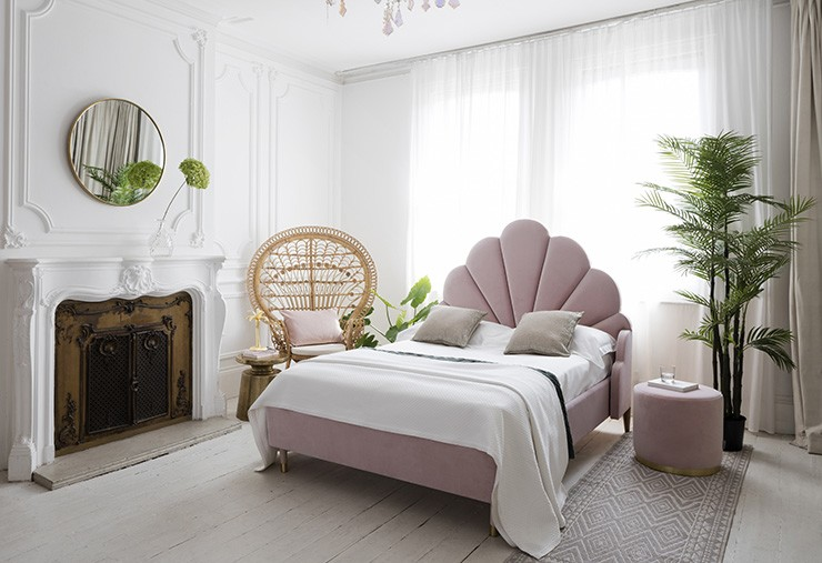 pink pastel scalloped headboard bed in on-trend master bedroom