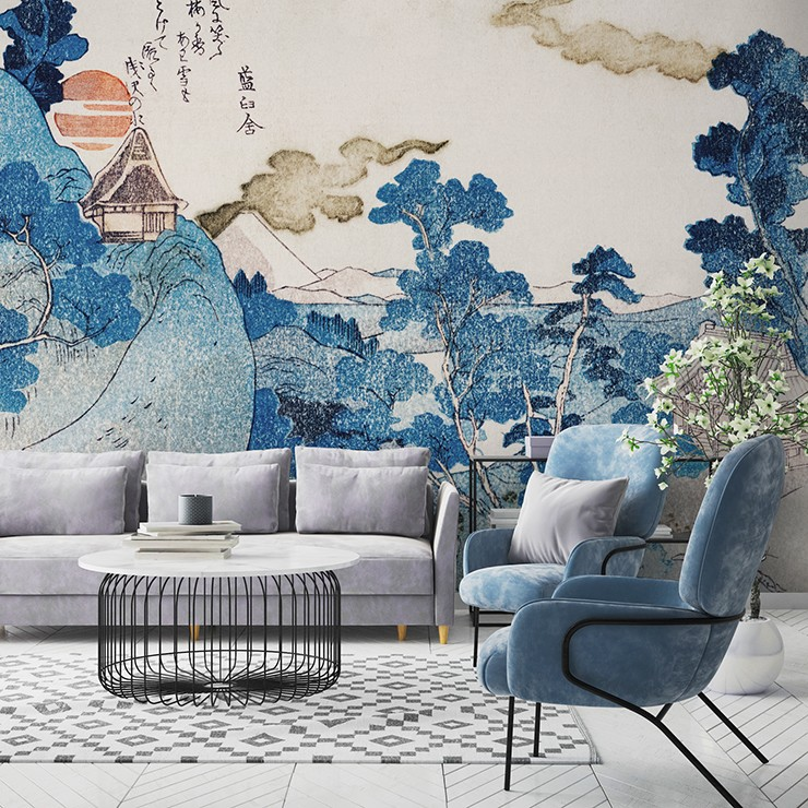 blue, white and orange oriental landscape wallpaper in lounge with modern blue velvet chair and grey sofa