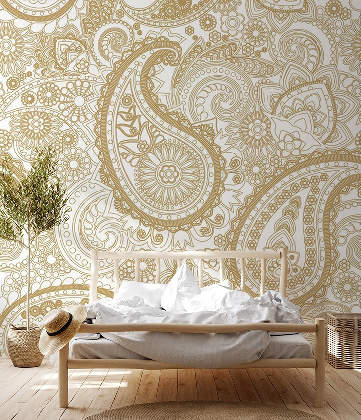gold colour and cream paisley wallpaper in boho wood and rattan bedroom