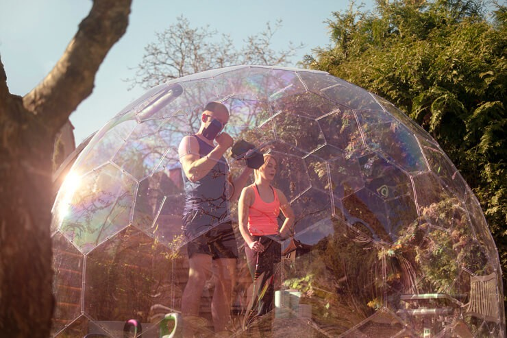 see through hypedome with people working out in it