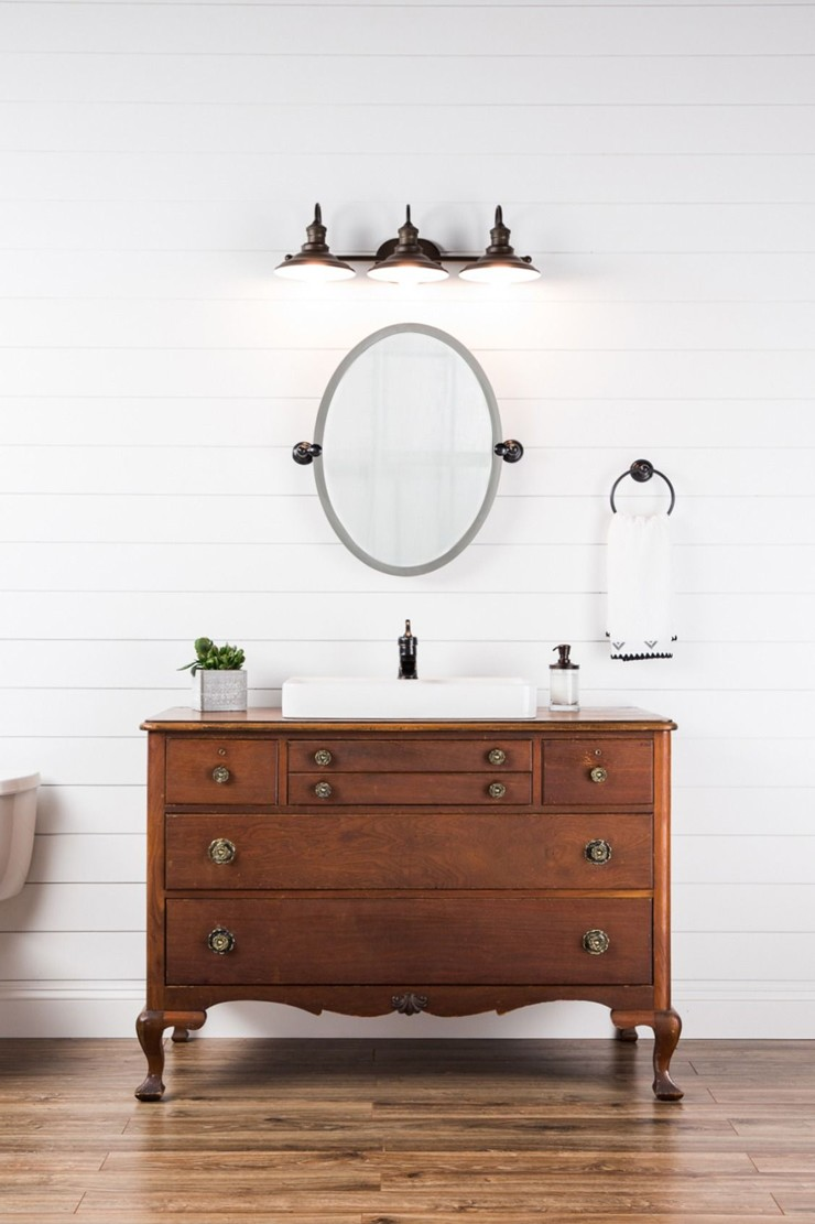 walnut coloured wooden vanity faucet in white large bathroom