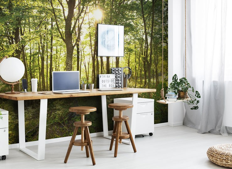 green forest wall mural in home office with wooden desk and stools