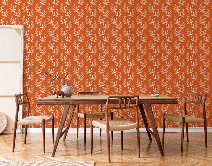 leaf pattern over orange wallpaper in wooden, minimalist dining area