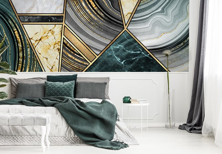 art deco abstract art in green and gold wallpaper in bedroom with grey, green and white bed