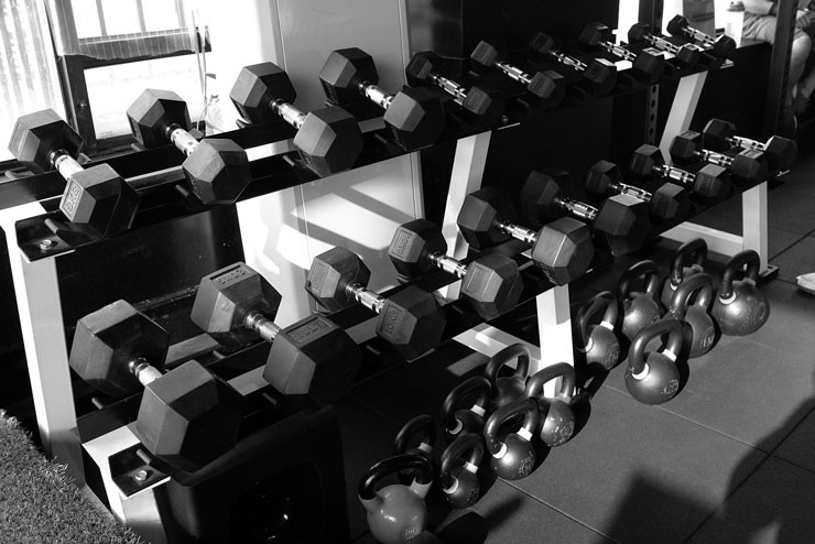 black and white photograph of stacked weights