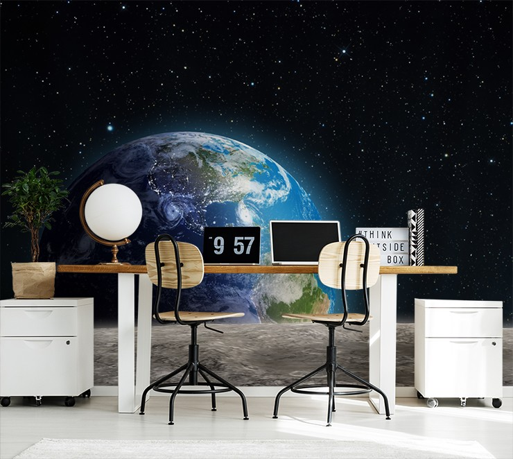 view of the earth from the moon wallpaper in trendy office with two desk chairs