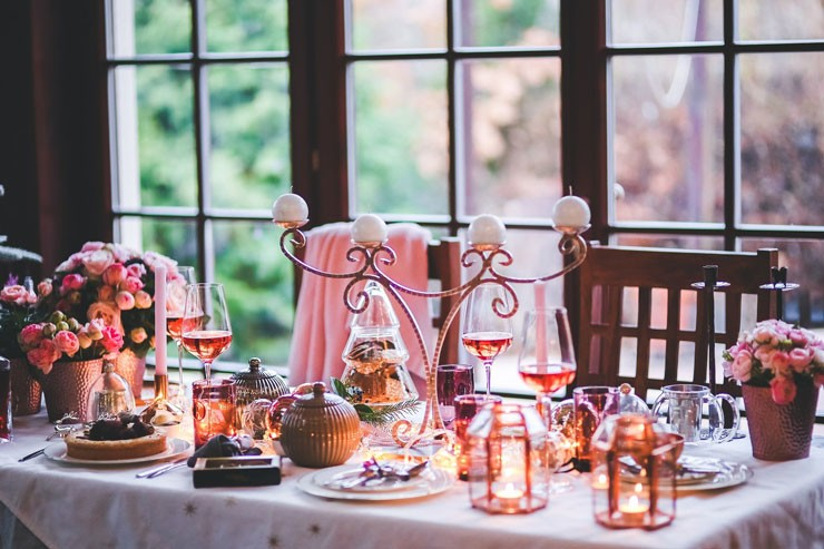 rose gold cutlery and candelabra with pink table decorations
