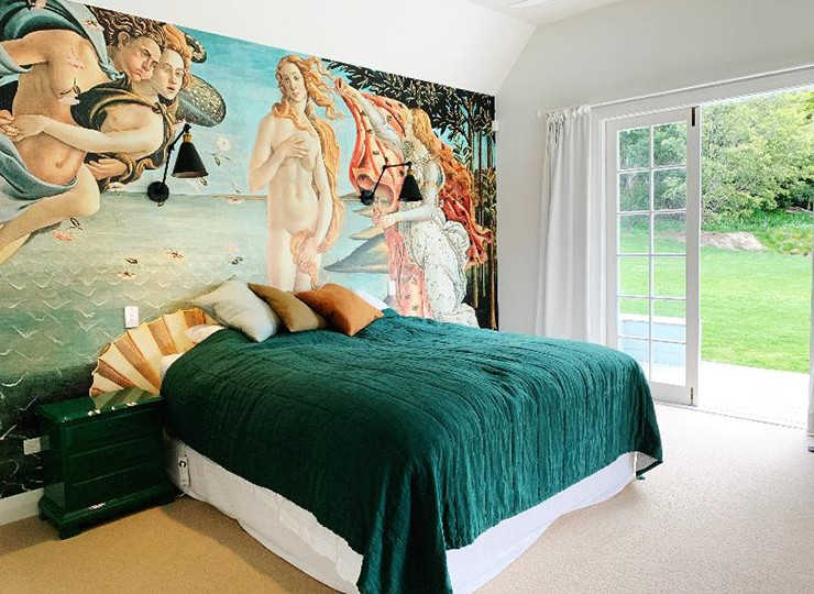 Botticelli painting of venus wallpaper in green and orange bedroom