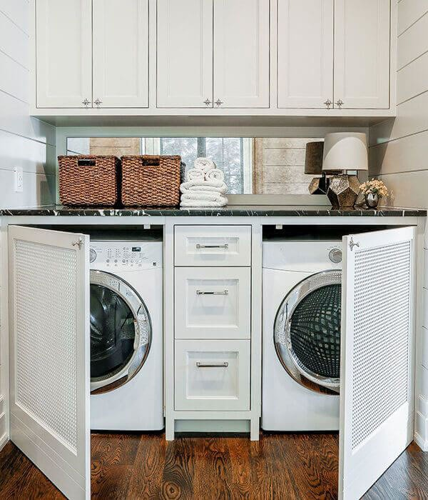white cabinetry hiding washer and dryer