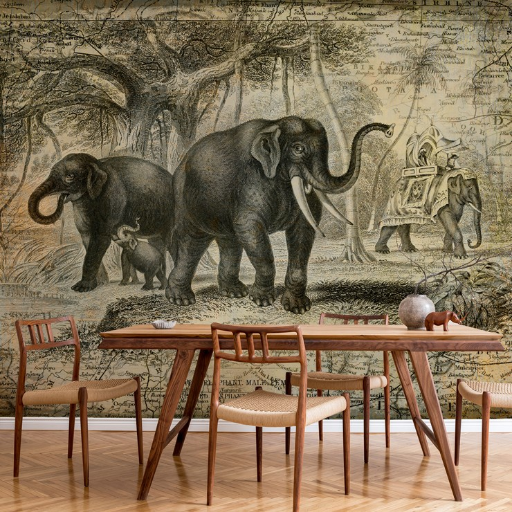 vintage black and off-white illustration of elephants in dining room with wood and wicker dining setin the jungle wallpaper
