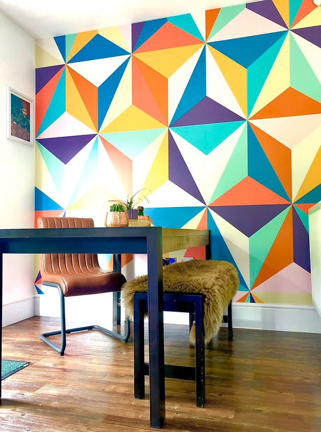 colourful retro geometric wallpaper in '70s style dining room